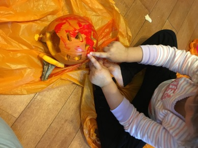 decorating pumpkin